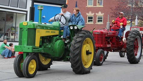 Tractors led the way at a parade Saturday in Bonner Springs. The ninth annual Marble Day parade and festival was Saturday, May 2, in Bonner Springs. (Photo by Steve Rupert))