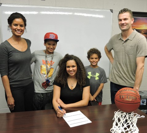 Signing a letter of intent to play basketball at Kansas City Kansas Community College next fall was a family affair for guard Brooklyn Wagler of Shawnee Mission Northwest. On hand were, from left, her mother, Jennifer Wagler; brothers Landon and Keaton Wagler; and her father, Logan Wagler. (KCKCC photo by Alan Hoskins)