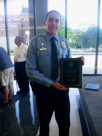 Jorge Flores was the class valedictorian at graduation for police recruits Thursday night. (Photo by William Crum)