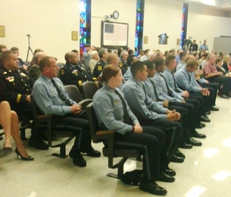 Nine Kansas City, Kan., police recruits graduated Thursday night in a ceremony at City Hall. (Photo by William Crum)