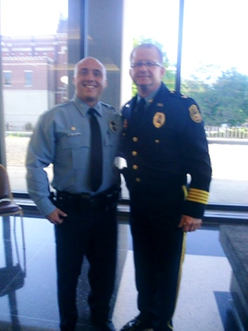 New police officer John Stimach with Police Chief Terry Zeigler at Thursday night's police recruit graduation. (Photo by William Crum)