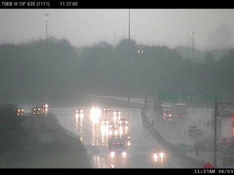 Motorists on I-70 west of I-635 in Kansas City, Kan., faced heavy rain and low visibility this morning. The National Weather Service has Wyandotte County under a flash flood warning until 3:30 p.m. For more weather information, visit www.weather.gov. (KC Scout photo)