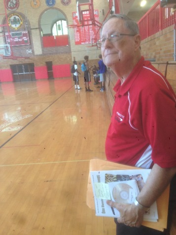 Craig Delich stood in the Wyandotte High School gym recently and discussed his book, which will include information about the high school's basketball prowess.  Delich, a former student and teacher at Wyandotte High School, has written a new history of the school that will be published in November. (Photo by Rebecca Tombaugh, Copyright 2015 by Rebecca Tombaugh)