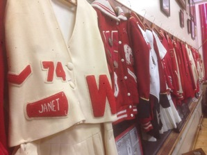 Old Wyandotte letter jackets and cheerleader gear. Craig Delich, a former student and teacher at Wyandotte High School, has written a new history of the school that will be published in November. (Photo by Rebecca Tombaugh, Copyright 2015 by Rebecca Tombaugh)