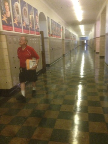 In the halls at Wyandotte High School. Craig Delich, a former student and teacher at Wyandotte High School, has written a new history of the school that will be published in November. (Photo by Rebecca Tombaugh, Copyright 2015 by Rebecca Tombaugh)