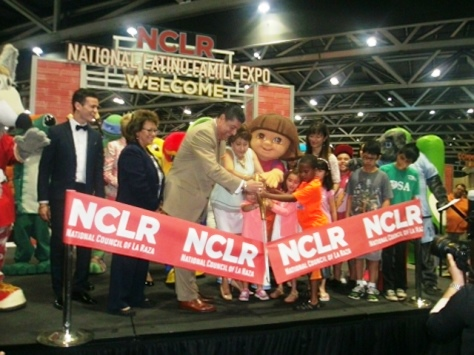 Janet Murguia, center, president and CEO of the National Council of La Raza (NCLR), helped cut the ribbon to open the national conference on Saturday in Kansas City, Mo. She is a native of Kansas City, Kan. (Photo by William Crum)