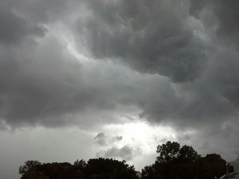 Rain moved through Kansas City, Kan., including this area near 72nd Street, about 5 p.m. Tuesday. More showers and storms are possible tonight and Wednesday, according to the National Weather Service.