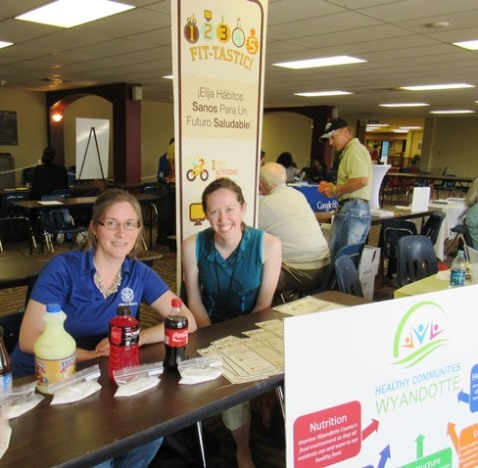 "The Healthy Communities Wyandotte coalition and the Wyandotte County Health Department were promiting the ""1-2-3-4-5 Fittastic"" program Saturday at the annual Back-to-School Fair at KCKCC. Staffing the table were Joanna Sabally, left, program coordinator Healthy Communities Wyandotte, and Danielle Landrum, healthy food access advocate for Healthy Communities Wyandotte. (Staff photo by Mary Rupert)"