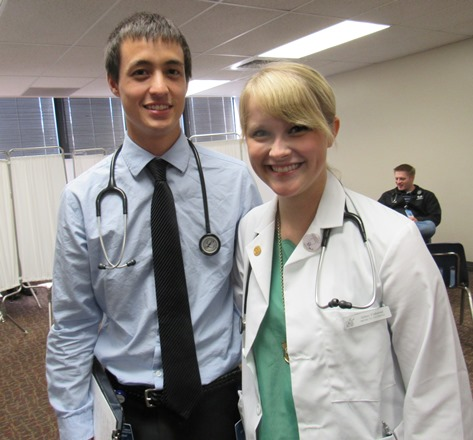 Connor Clarkston, left, and Abbey Elsbernd, first-year medical students at the University of Kansas School of Medicine, were among the volunteers today at the annual Back-to-School Fair at KCKCC. The volunteers helped with taking patient histories and physicals. (Staff photo by Mary Rupert)