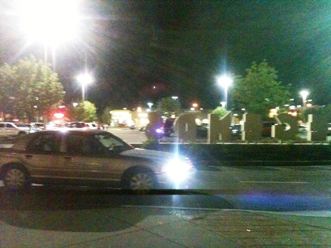 Police responded to the north side of The Legends Outlets Saturday night. A group of teenagers was gathered there. A helicopter circled overhead.