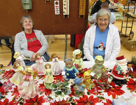 Corinne Larkin, right, painted ceramic figures on display Saturday at the Eisenhower Craft Fair, Kansas City, Kan. With her was Karen Bales, left. (Staff photo)