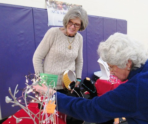 Marion Tommer made jewelry that was on display Saturday at the Eisenhower Craft Fair, Kansas City, Kan. (Staff photo)