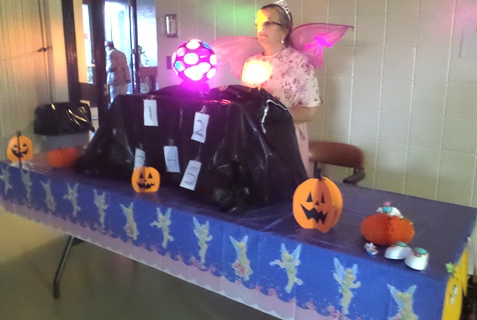 Sue Reaves from Christ the King assisted at the safe Halloween event Saturday evening at the Eisenhower Recreation Center, Kansas City, Kan. (Photo by Lou Braswell)