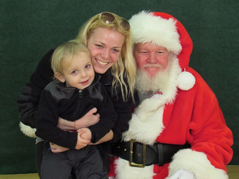 Santa Claus was helping Special Olympics on Saturday at the Eisenhower Craft Fair. Proceeds from the photos sold at the event were going to Special Olympics. (Staff photo)