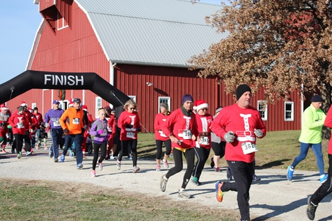 The Santa Express and 5K run took place on Saturday, Dec. 5, at the National Agricultural Center and Hall of Fame, 126th and State Avenue, Bonner Springs. The event included a 5K run, a 1K walk, as well as a visit with Santa Claus, a ride on the miniature train, games, crafts, cookies and hot chocolate. Santa in the Train Depot will continue from 1 p.m. to 4 p.m. Dec. 6; 10 a.m. to 4 p.m. Dec. 12; and 1 p.m. to 4 p.m. Dec. 13. Proceeds from the event benefit Ag Hall programs. For more information see the Facebook page for the National Agricultural Center Hall of Fame. (Photo by Steve Rupert)