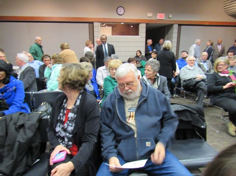 A large crowd chatted at the library before the start of the Wyandotte County legislative delegation forum on Jan. 5. (Staff photo by Mary Rupert)