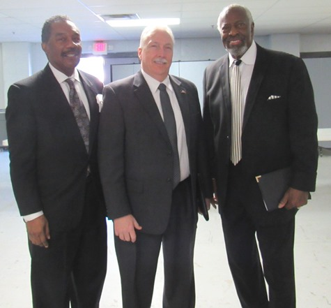 Chatting before a community meeting on foster care today at the Greater Pentecostal Temple were, left to right, Associate Pastor Tommy Hughes, Kansas House Democratic Leader Tom Burroughs and Bishop Marvin Donaldson. (Staff photo)