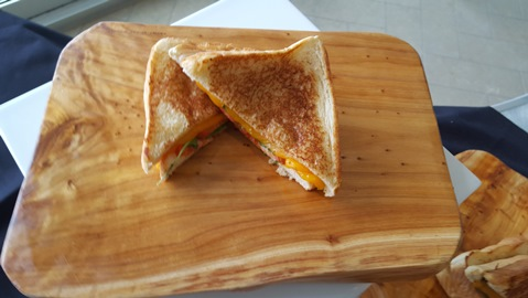 The tomato-arugula grilled cheese includes manchego cheese, arugula and tomato jam on grilled Texas toast. (Photo by William Crum)