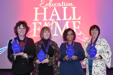 Mid-America Education of Fame awards were presented to, from left, Rhonda Hassig, Pam Louis-Walden, Melanie Jackson-Scott and Anita Reach at 20th annual induction ceremonies. Hassig accepted for her husband, Rob, who was out of the country; Louis-Walden for her late husband, Henry Louis. (KCKCC photo by Alan Hoskins)