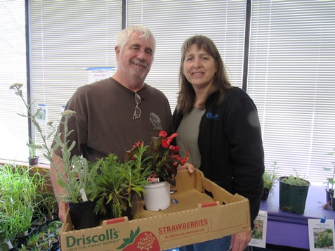 Marsha and Tim Kienzle, shopped for plants at the Master Gardeners Plant Sale Saturday, April 30, at the Extension Office, 1200 N. 79th St., Kansas City, Kan. The sale runs through 2 p.m. Saturday. They had tomato and pepper plants, herbs, hanging baskets, flowers and more available. Proceeds benefit the Master Gardeners' activities in Wyandotte County. (Staff photo by Mary Rupert)