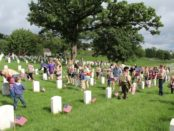 Boy Scouts, Cub Scouts and other youth from  the Greater Kansas City area, including Kansas City, Kan., helped place flags on veterans' gravemarkers on Saturday morning at the Leavenworth National Cemetery, near K-7 and K-5 in Leavenworth, Kan.  Monday is Memorial Day, which is set aside to honor those who died in service to their country. The U.S. Census Bureau estimated that more than 1 million U.S. men and women have died in military service since the Civil War. (Photo by Steve Rupert)
