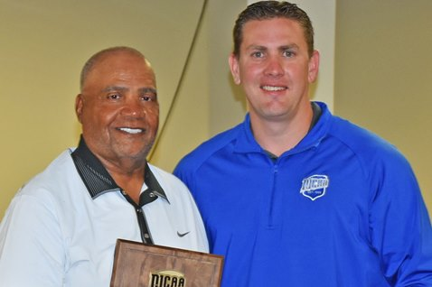 Coaching track for nearly 40 years including 20 at Kansas City Kansas Community College has earned Al Hobson, left, induction into the NJCAA Track and Field Hall of Fame. KCKCC Athletic Director Tony Tompkins made the presentation of the NJCAA plaque at a meeting of the KCKCC Board of Trustees Tuesday. (KCKCC photo by Alan Hoskins)