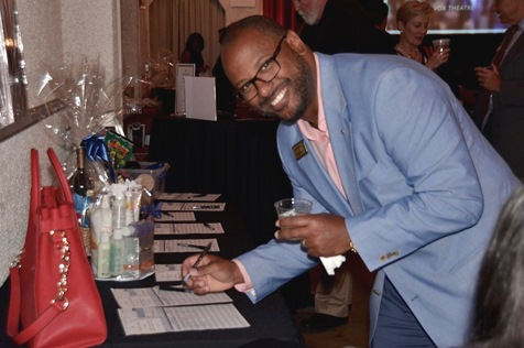 Eric McTye, UWWC board member and Edward Jones, places a bid in the silent auction at UWWC's annual campaign celebration. (Photo from United Way of Wyandotte County)