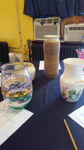 A benefit art auction for Alcott Arts Center, 180 S. 18th, Kansas City, Kan., was held Saturday evening. Vases and lamps made by art honors students at Blue Valley Northwest High School were auctioned off to benefit the Alcott Arts Center. (Photo by William Crum)