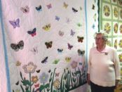 Ruth Schultz displayed her butterfly quilt, which she designed and hand-quilted, at the 40th annual Grinter Quilt Show last weekend in Kansas City, Kan. (Staff photo by Mary Rupert)