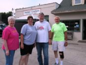 Animal Crackers feed store at 81st and Leavenworth Road reopened today with new owners, Stacey and Rick Sheahan, center. They were with customers Carolyn Pooler, left, and Gene Pooler, right. (Staff photo)