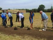 Unified Government officials broke ground today on the site of the new South Patrol police station at 21st and Metropolitan Avenue. The Walmart Neighborhood Market is in the background to the left. (Staff photo)