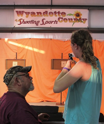 The 4-H shooting sports program held a BB-gun shooting booth inside the red barn at the Wyandotte County Fair on Wednesday. There is also a no gun sign posted at the entrance of the county fair, and guns are not allowed to be brought in. (Staff photo by Mary Rupert)