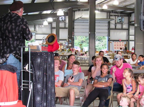 The audience enjoyed a magic show at the red barn on Wednesday at the Wyandotte County Fair. (Staff photo by Mary Rupert)