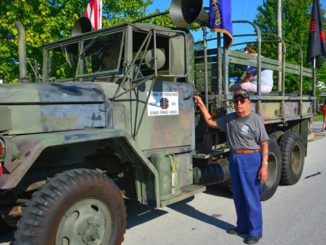 Pete Gomez of Bonner Springs, Kan., a Korean War veteran, showed off his 1974 AMD utility truck before the Tiblow Days Parade on Aug. 27. .(Photo by Brian Turrel)