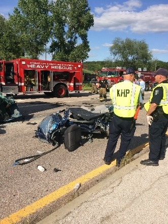 Two persons injured after wreck at K-32 and I-435