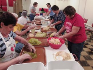 Preparing sarma (cabbage rolls) today for the eighth annual Slovenefest on Saturday at Holy Family club, 513 Ohio St., Kansas City, Kan., were, from left, on the left side, Carol McCarty, Helen Zagar, Jean Keller, Margie Supplee, Patty Horton, and starting at the back on the right side, Patty Westfall, Annette Denton and Ramona Conaway. (Staff photo by Mary Rupert)