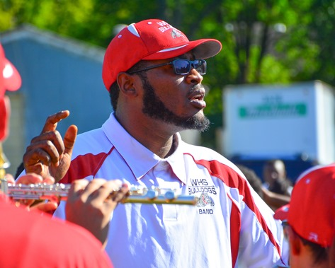Deandre Tatum, assistant director of the Wyandotte High School Marching Band, led the band in a song during a Battle of the Bands with Washington High School following the Leavenworth Road Parade. (Photo by Brian Turrel)