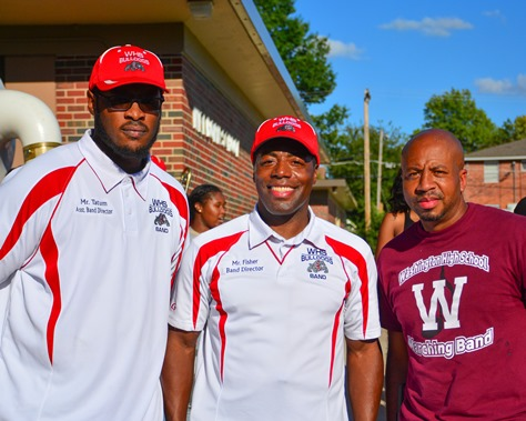 Deandre Tatum, Osmond Fisher, and Christopher Green, of the Wyandotte and Washington high school marching bands, posed together following the completion of a Battle of the Bands between their two schools. (Photo by Brian Turrel)