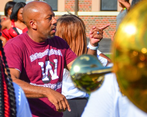 Christopher Green, director of the Washington High School Marching Band, led the band in a song during a Battle of the Bands with Washington High School following the Leavenworth Road Parade. (Photo by Brian Turrel)