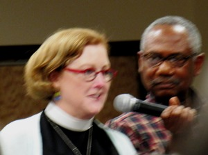 The Rev. Dixie Junk, left, priest in charge at St. Paul's Episcopal Church, at the forum Tuesday invited the community and the police to have a conversation at St. Paul's breakfasts on Saturday morning. (Staff photo by Mary Rupert)