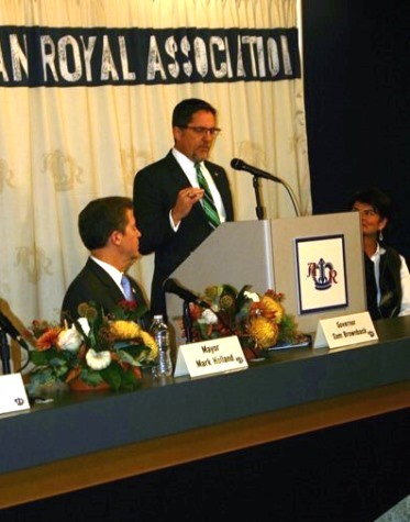 Kansas City, Kan., Mayor Mark Holland, at the podium, and Gov. Sam Brownback, left, spoke at today's announcement that the American Royal plans to move to Wyandotte County. (Photo by Murrel Bland)