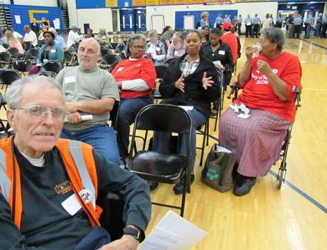 Dan Welch, left, a Kansas City, Kan., resident, chatted with residents before the start of the community forum on reducing violence. He said he was there to listen. The meeting was at Schlagle High School. (Staff photo by Mary Rupert)