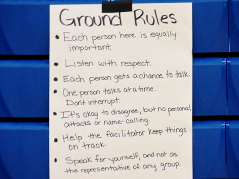 Ground rules were outlined for small group discussions tonight at the community forum on reducing violence. The meeting was at Schlagle High School. (Staff photo)