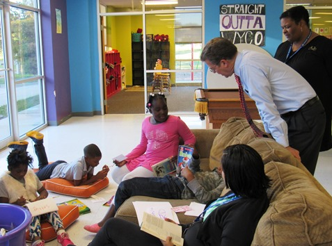Gov. Sam Brownback talked with students in an independent reading group on Thursday at the Boys and Girls Club. (Staff photo)