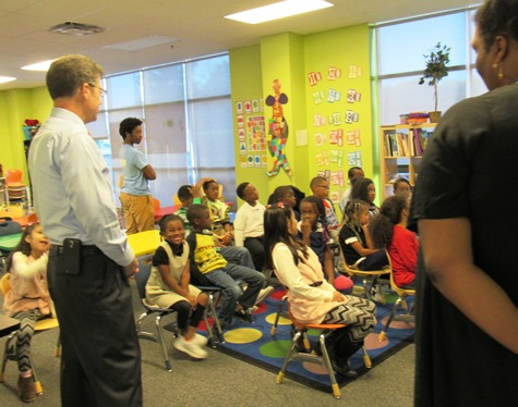 Gov. Sam Brownback, left, visited a classroom at the Boys and Girls Club on Thursday in Kansas City, Kan. (Staff photo)