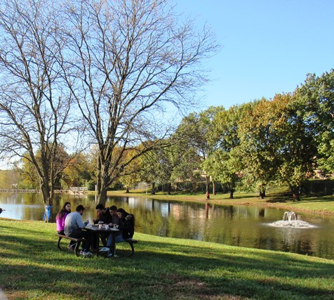 Several persons attending today's dedication ate a breakfast by the pond or lake at KCKCC. (Staff photo)