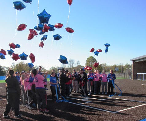 As the ribbon was cut for the new softball field, members of the softball team released balloons. (Staff photo)