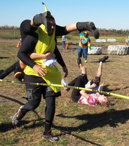 A couple from Omaha, Neb., right, took a tumble in the wife-carry event Saturday at Lakeside Speedway in Kansas City, Kan. The event was a benefit for the Reola Grant Center. (Staff photo)