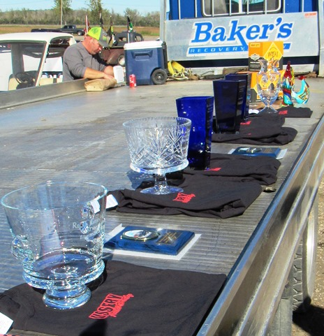 Several trophies were lined up Saturday at a fundraiser for the Reola Grant Center, including trophies for the car show. (Staff photo)