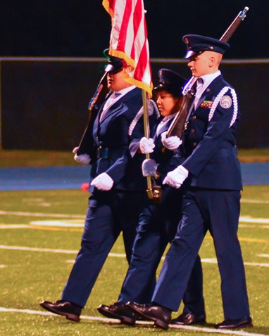 The Washington High School Air Force ROTC color guard presented the flag before the game. (Photo by Brian Turrel)